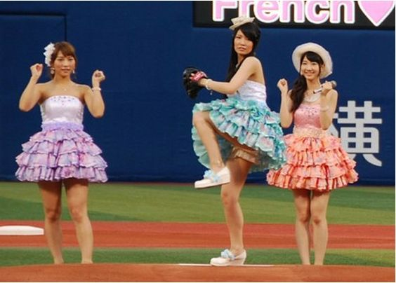 AKB48's Kuramochi Asuka throws a dead ball during opening pitch