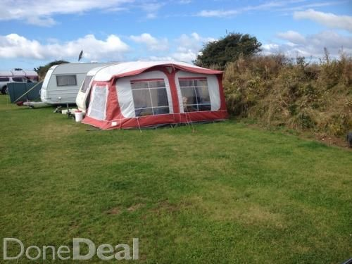 1 double bed at front , 1 double bed and bunk. at rear. Shower and cassette toilet in the middle with storage shelves and wardrobe.   Hot and cold water.   Water pump.   Gas hob, oven and grill.   Fridge  Mains electric,    Black out Blinds, and Fly screens on some windows.  Curtains on all windows.  Anti sway hitch.  Leisure Battery  Comes with full awning as seen in pictures and has additional roll out canopy on opposite side which is attached to caravan.   This caravan was never abused…