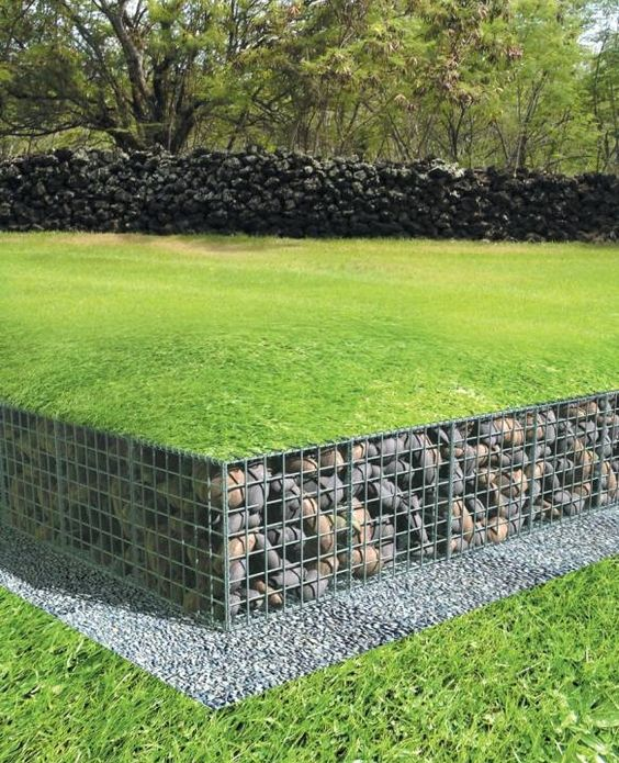 low gabion wall with lawn over top of gabions: