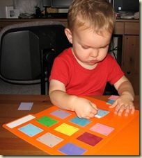 color matching game using paint chips and file folders.