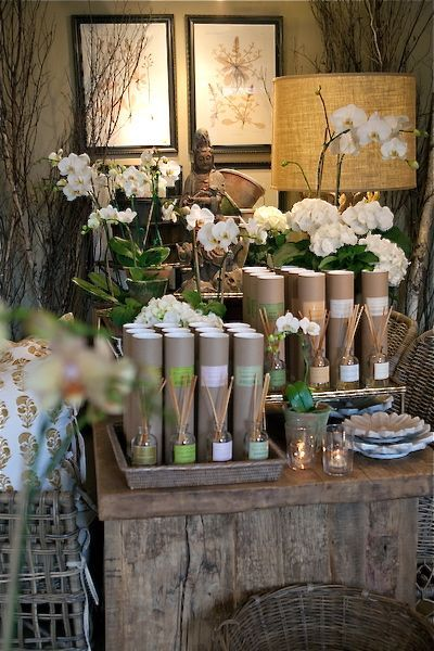 Love the orchids, rustic table, buddha, & candles!   Shop