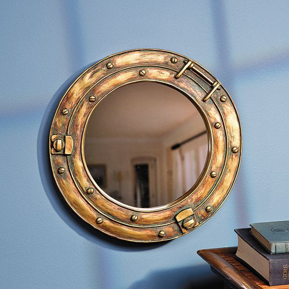 Porthole Mirror - OrientalTrading.com  Add fish decals to give the appearance of looking through submarine window
