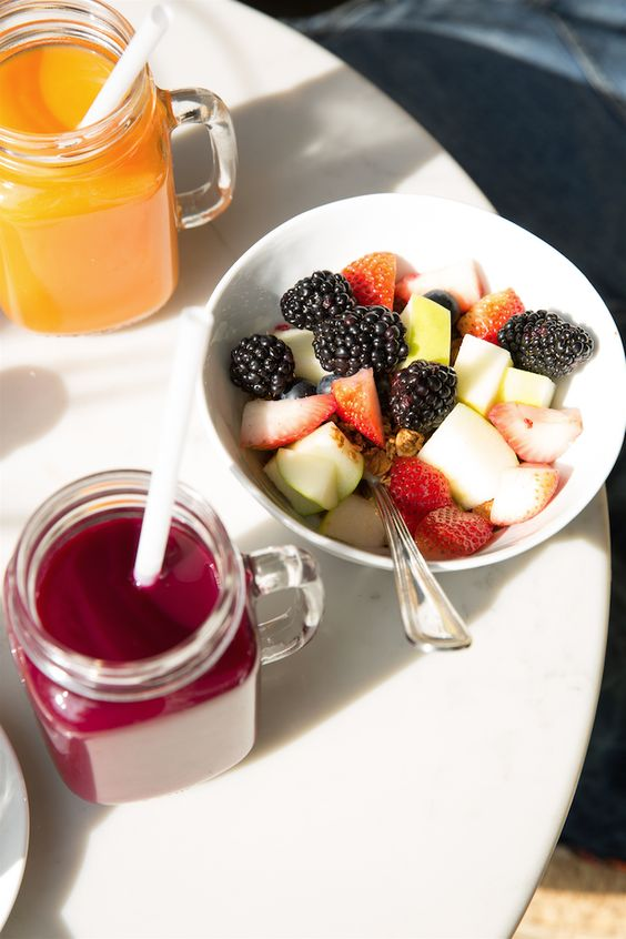 Fresh fruit juice and a mixed berry salad are a great healthy meal anytime of day!