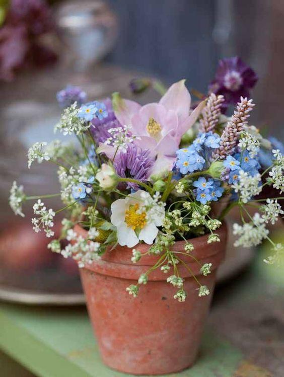 floral arrangement in clay pot