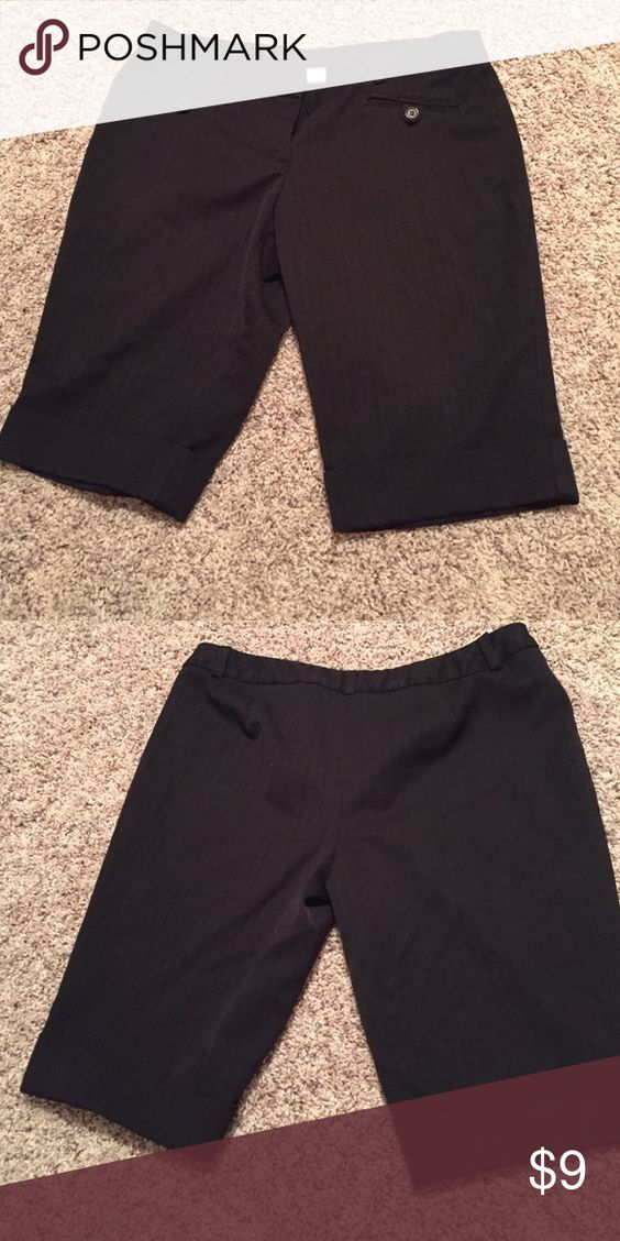 Black silk shorts These shorts are used and in good condition. I only wore them once. Did not like the way they fit. No Boundaries Shorts Bermudas