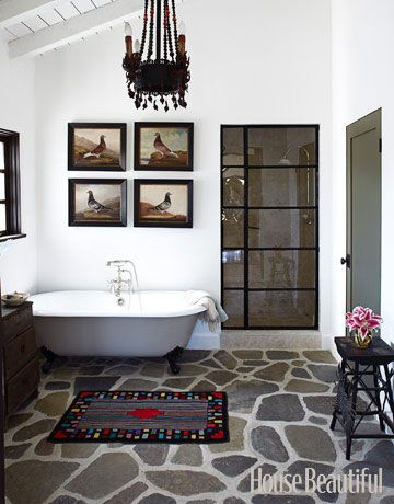 A Spanish-style country bathroom. Designed by Kelley McDowell. housebeautiful.com #bathrooms #unique_flooring #clawfoot_bathtub #shower_door
