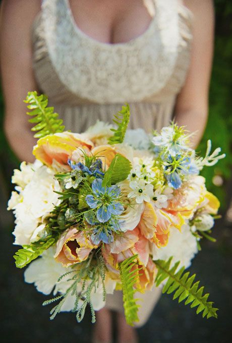 French Tulip Bridesmaid Bouquet. The bridesmaids carried round, white bouquets that burst with punches of peach French tulips and lush green ferns.