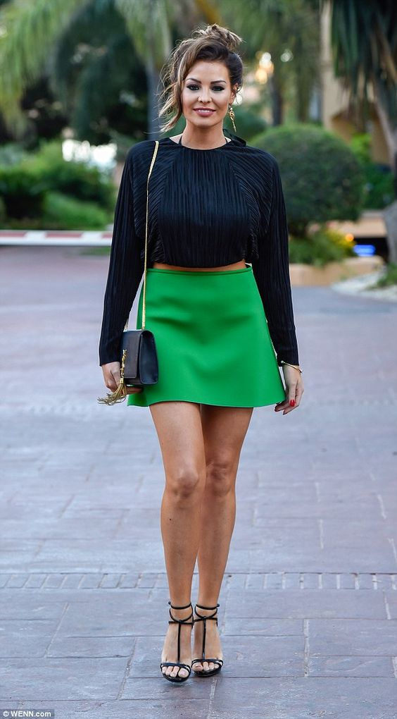 Leggy look: Jessica Wright highlighted her lithe limbs in a little green miniskirt and str...