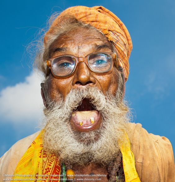Screaming eccentric old indian man with thick vintage ...