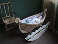 Viking Boat rocking cradle by ©Richard Keal, Sussex, UK sculptor, carpenter and joiner