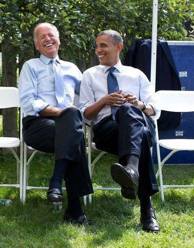 President Obama and Vice President Joe Biden share a laugh...