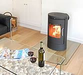 This stylish Morso wood burning stove hides the flue discreetly behind and looks totally chic.