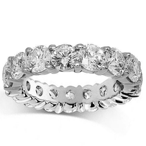 This elegant eternity band is handcrafted in 18K white gold. Brilliant round cut diamonds are prong set all the way around the band and total to 4.50 carats. The frame measures to 3/16 inches in width and weighs 4.5 grams. $9,786.00