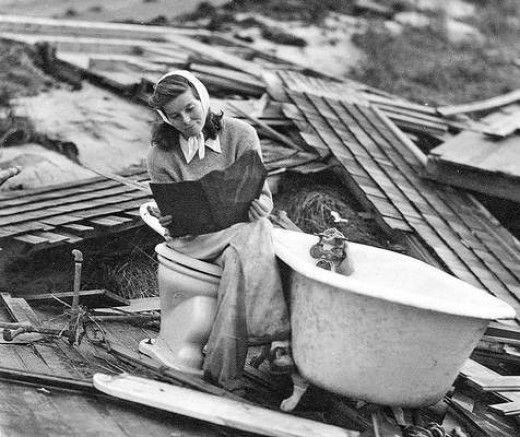 #SummerUnderTheStars Katharine Hepburn searching through the debris of her Fenwick home after the #Hurricane of 1938.