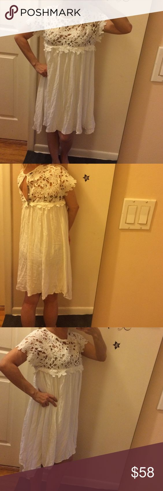 """My Story BNWT white dress floral top Personal favorite. If I weren't locating Abd it wasn't a medical emergency, this I would definitely keep. Bust: 17"""". Trapeze dress. Made of rayon and embroidered flowers on top, polyester. Polyester lining. Neck opening: 11.5"""" with button behind neck. Sleeves: 9.5"""" arm opening 8.5"""". Mid neck to bottom of flowers: 6.5"""" total length of dress: 34"""". Extra button attached to tag. I'm normally an xs and it's a little big, but the style of the dress, I'd still…"""