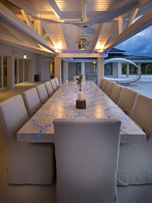 Gorgeously Unique Outdoor Dining Space With Glowing Cracked Stone Table And  Uniform Neutral Chairs