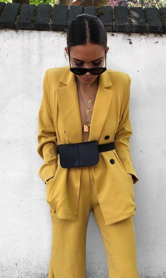fashionable outfit / yellow suit and black waist bag
