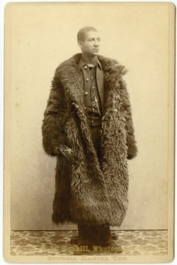 Photographed by John C. H. Grabill in Sturgis, Dakota Territory, circa 1886, this cabinet card depicts an unknown soldier in the 25th Infantry and is the only known image of a Buffalo Soldier wearing a buffalo robe.
