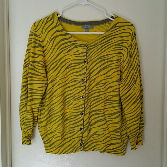 Zebra print cardigan Fun and wild cardigan that instantly brightens up an outfit! It is 3/4 sleeve.   Some signs of wear on this one. The tiniest hole on a seam on the top and some light pilling under the arms. It still has love to give though.  Will bundle items delias Sweaters Cardigans
