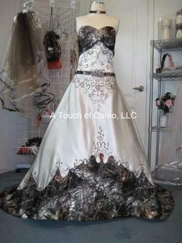 Anita is a strapless ball gown with cathedral train in for Camo accented wedding dresses
