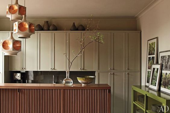 The kitchen cabinets are painted in Benjamin Moore's Gettysburg Gray, while…