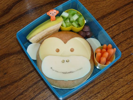 {Monkeying around} Banana, celery, Trader Joe's mini peanut butter cups, carrots, and a bagel thin with Swiss and smoked Gouda cheese. Cute lunch ideas!