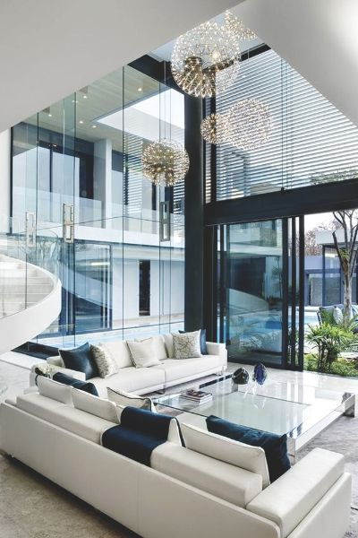 I discovered this living room and immediately feel in love with it. Although I could never afford a house that big, or even a sofa that size, I cannot help but dream of owning a house like that someday. Do not get me wrong, I have a lovely small house and