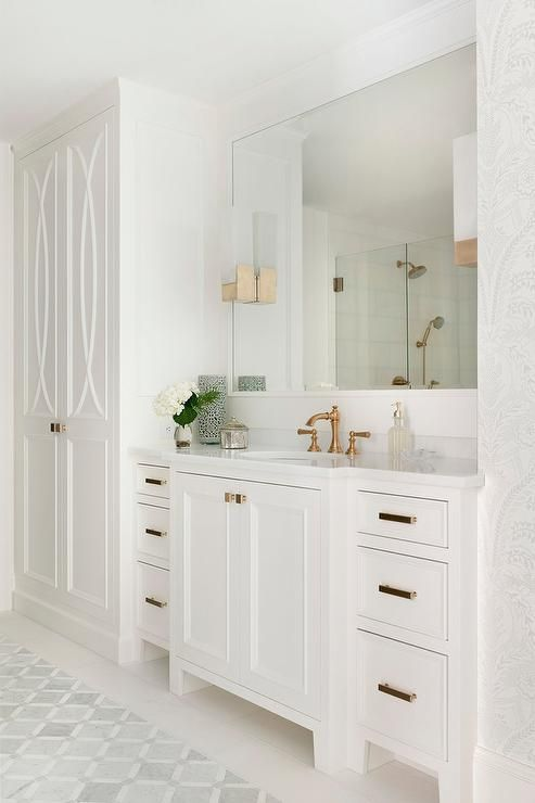 Luxurious White Bathroom Features Floor To Ceiling