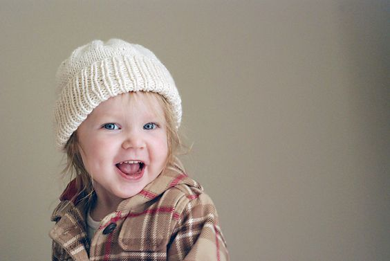 The number one item every child needs in their winter wardrobe is a hat, and the best sort of hat is the kind that does its job well. A basic hat will match most items in even the most eclectic fashionista closet. For extra flare, add a bit of fair isle, or, for a sporty edge, just add a few stripes in the child's favorite color. With 3 different patterns to choose from for the brim, you can get creative while still keeping things simple and easy to knit.