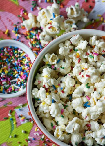 This Funfetti Popcorn would be so good on the snack table at a kid party. http://thestir.cafemom.com/food_party/143264/sweet_salty_cake_batter_popcorn: