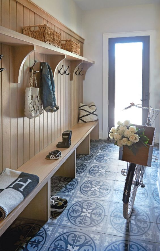 """Isn't this the prettiest and most clever use of a back hall? The great storage options for this """"drop zone"""" are perfectly simple, and…"""