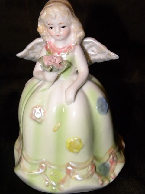 Porcelain angel bell. Got her at Goodwill for 1.99 She will look sweet up on a shelf in the nursery.
