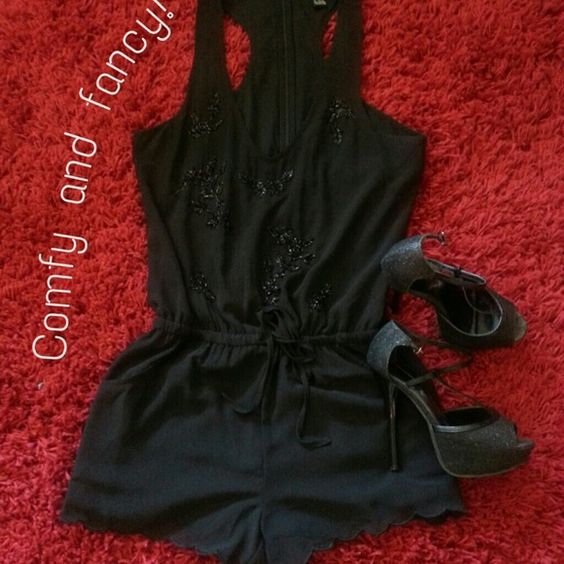 Black romper! So comfy and stylish, very pretty embroidery, worn once! Excellent condition. Forever 21 Dresses