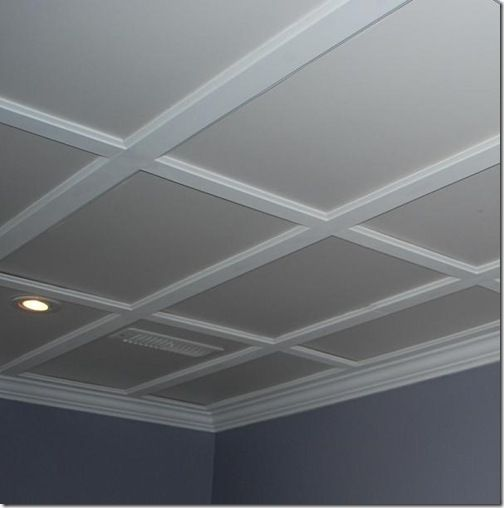 Drop ceiling tiles supported by molding with RECESSED lighting. Looks like coffered ceiling! Love this look for the basement!