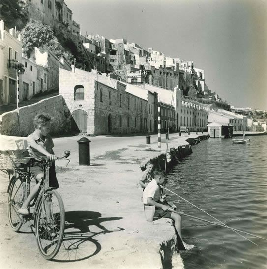 Boy and bicycle in Spanish port – c.1954