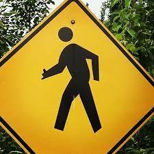 Hawaiian shaka sign at crossing