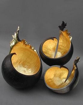 Kay Lynne Sattler makes pit fired coil pots with gold leaf.  Inspired by the volcanic forms of her home in Hawaii.