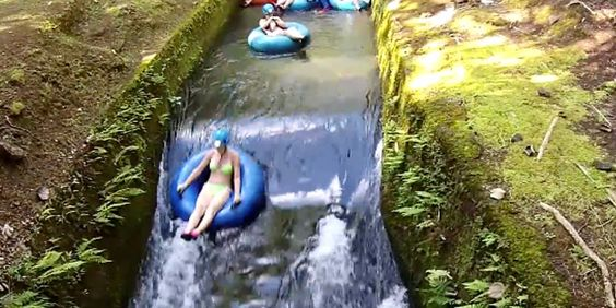 Hawaii- It's the coolest lazy river ever, and includes caves and rapids.