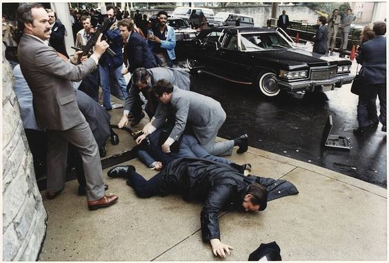 The Reagan assassination attempt, 1981   The Reagan assassination attempt occurred on March 30, 1981, at the Washington Hilton Hotel in D.C., when John Hinckley Jr. opened fire on Reagan and three others. After the shooting, Reagan was thrown into the limousine, unaware that he had been shot. He only realized this when he coughed up blood and discovered that his lung had been punctured.   Photo and text via: all-thats-interesting.tumblr.com  