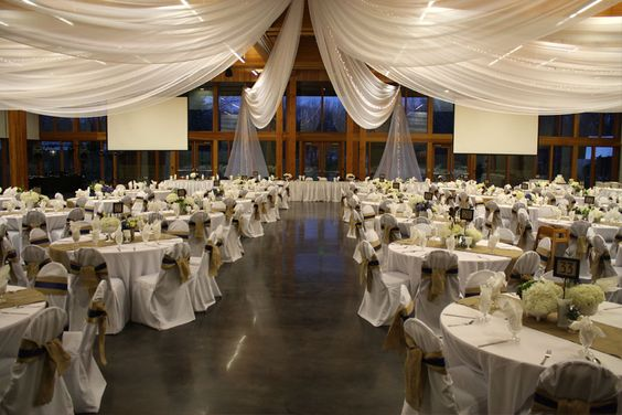 round tables, burlap runners, and draped ceiling... soft, elegant and simple!