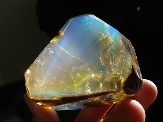 This is another kind of opal, called the Fire Opal. It's found in Mexico and inside seems to be filled with flames or a sunset.: