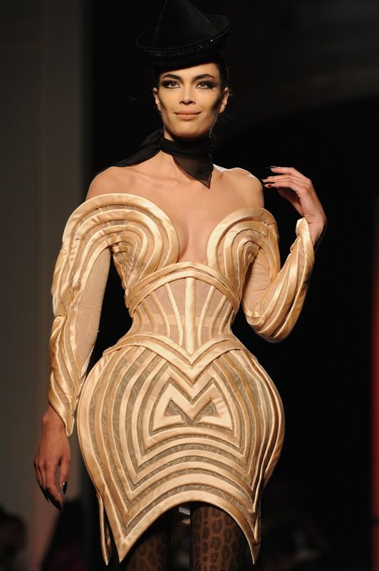 Jean Paul Gaultier Haute Couture A/W 2013 Is this an homage to Madonna? I can't help looking at JPG's corset dresses and thinking of the corsets and cone bras he made for La Ciccone's tour.