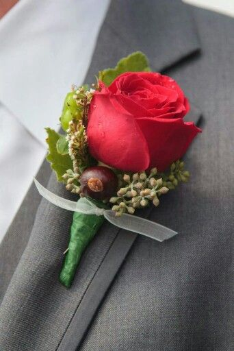 Wedding - Groom's boutonniere.  This groom is a huge Ohio State fan.  The wedding colors were scarlet and grey.  Small buckeyes were added to the boutonnieres to further show his love for the OSU buckeyes - such a cool idea - looked awesome!!