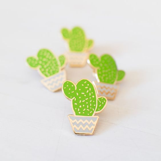 A chubby little green cactus in a light grey pot, detailed with gold coloured metal. Made from the highest quality hard enamel, this smooth pin