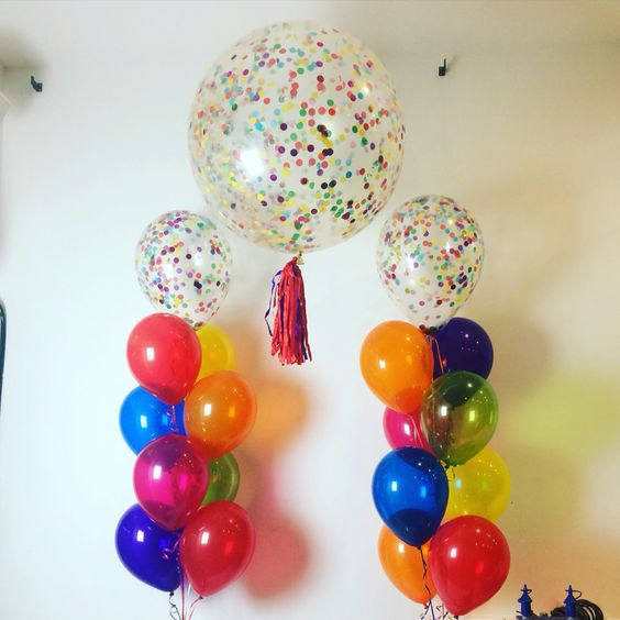Rainbow confetti with a rainbow mix of Qualatex Jewel tone (crystal) balloons. Sure to brighten up this birthday party!: