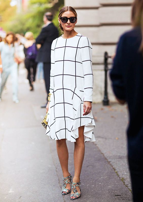 Olivia Palermo in a white and black grid print long sleeve dress and printed heels: