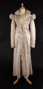 Bonhams : An early 19th century redingote of figured cream silk and a cream silk dress