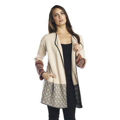 Our favorite piece to take you from the dog days of summer into chilly Fall, combines urban chic with a bohemian vibe. It's the perfect go-to piece and features vegan leather trim, side pockets and a striking block of color on body and arms. 100% cotton. XS-L. Machine wash cold gentle cycle with like colors, non-chlorine bleach only. Reshape and lay flat to dry. Warm iron as needed. ArhausJewels.com.