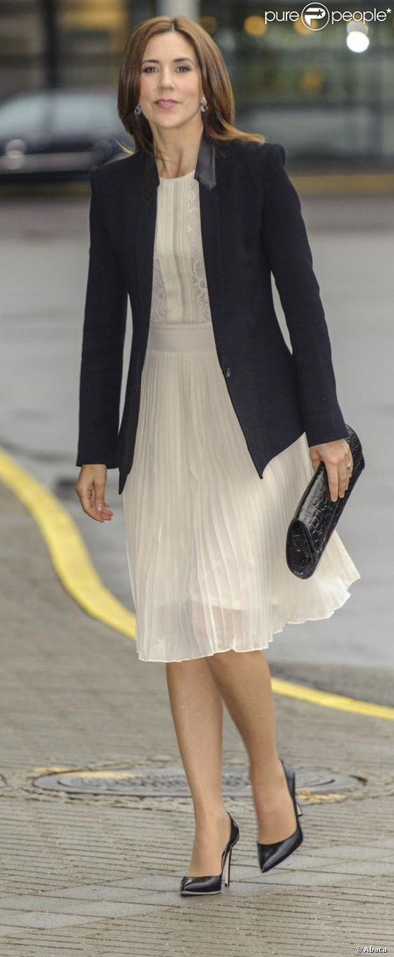 Crown Princess Mary of Denmark.  I love the idea of balancing a girlish dress with a blazer.