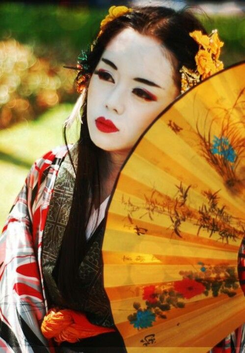 Geisha with yellow umbrella